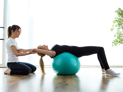 Physiotherapist fitness ball